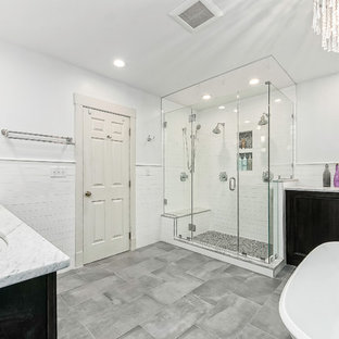 Inspiration for a mid-sized contemporary white tile and subway tile porcelain floor and gray floor bathroom remodel in Columbus with recessed-panel cabinets, black cabinets, gray walls, an undermount sink and a hinged shower door