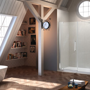Example of a mid-sized eclectic light wood floor bathroom design in West Midlands with gray walls