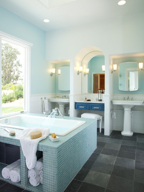 trendy mosaic tile and blue tile bathroom photo in san luis obispo with a pedestal sink