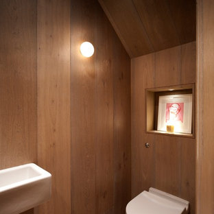 Inspiration for a small contemporary 3/4 light wood floor bathroom remodel in London with a wall-mount sink and a one-piece toilet