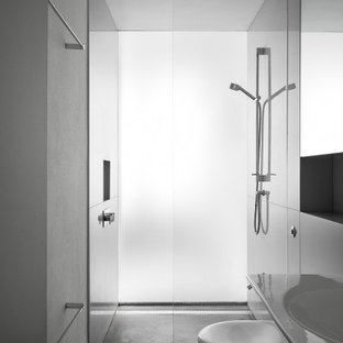 Photo of a medium sized modern shower room bathroom in London with a walk-in shower, a wall mounted toilet, grey walls, concrete flooring, a wall-mounted sink and grey floors.