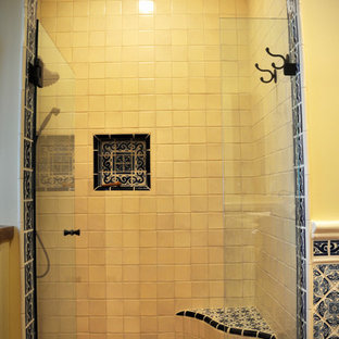 Design ideas for a medium sized shower room in San Diego with recessed-panel cabinets, distressed cabinets, an alcove shower, yellow walls, terracotta flooring, a vessel sink, wooden worktops, red floors and a hinged door.