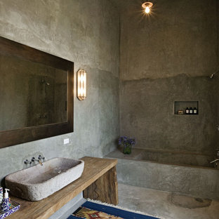 Photo of a mediterranean bathroom in New York with a vessel sink, an alcove bath, a walk-in shower and an open shower.