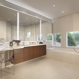 Example of a trendy master beige tile bathroom design in Miami with flat-panel cabinets and dark wood cabinets