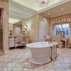 mediterranean bathroom by MICHAEL MOLTHAN LUXURY HOMES