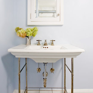Example of a classic mosaic tile bathroom design in Boston with a console sink