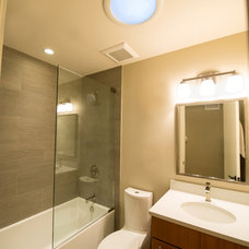 Midcentury Bathroom by Kristin Petro Interiors, Inc.