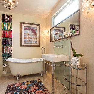 Eclectic beige floor claw-foot bathtub photo in Los Angeles with beige walls and a console sink