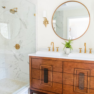 Example of a mid-century modern 3/4 white tile mosaic tile floor and white floor corner shower design in Other with furniture-like cabinets, medium tone wood cabinets, white walls, a drop-in sink, a hinged shower door and white countertops