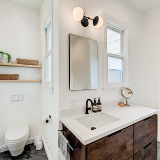 Inspiration for a transitional 3/4 gray floor bathroom remodel in San Francisco with flat-panel cabinets, dark wood cabinets, a one-piece toilet, white walls, an undermount sink and brown countertops