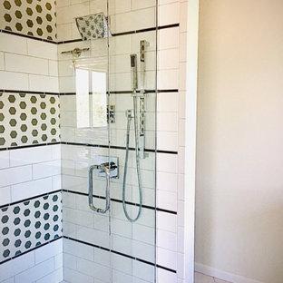 Cette image montre une douche en alcôve principale vintage de taille moyenne avec un placard à porte plane, des portes de placard en bois sombre, une baignoire indépendante, un carrelage multicolore, des plaques de verre, un mur blanc, un sol en carreaux de ciment, un lavabo encastré, un plan de toilette en quartz, un sol blanc, une cabine de douche à porte battante, un plan de toilette blanc, meuble double vasque et meuble-lavabo suspendu.