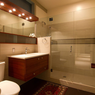 Alcove shower - contemporary beige tile alcove shower idea in Portland with flat-panel cabinets, dark wood cabinets and a two-piece toilet