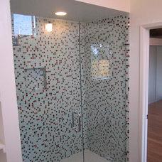 Modern Bathroom by Green Button Homes LLC