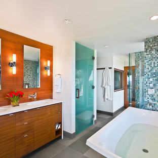 Example of a large 1950s master blue tile, gray tile, green tile, multicolored tile and glass sheet gray floor bathroom design in Santa Barbara with flat-panel cabinets, medium tone wood cabinets, white walls, an undermount sink, a hinged shower door and white countertops