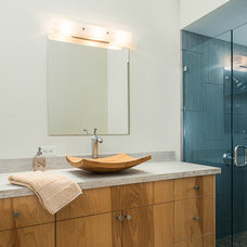 Midcentury Bathroom by Iconic Properties