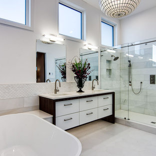 Example of a huge trendy master white tile and porcelain tile ceramic tile, white floor and double-sink bathroom design in Portland with flat-panel cabinets, white cabinets, white walls, quartz countertops, white countertops and an undermount sink