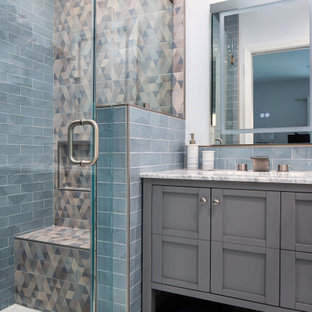 Inspiration for a small 1960s kids' blue tile and ceramic tile marble floor, white floor and single-sink alcove shower remodel in Los Angeles with shaker cabinets, gray cabinets, a two-piece toilet, white walls, an undermount sink, marble countertops, a hinged shower door, white countertops, a niche and a freestanding vanity