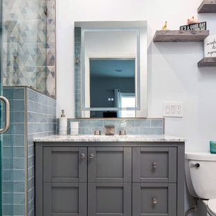 Example of a small 1950s kids' blue tile and ceramic tile marble floor, white floor and single-sink alcove shower design in Los Angeles with shaker cabinets, gray cabinets, a two-piece toilet, white walls, an undermount sink, marble countertops, a hinged shower door, white countertops, a niche and a freestanding vanity