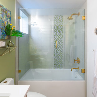 Inspiration for a mid-sized 1960s 3/4 white tile and ceramic tile porcelain tile and beige floor bathroom remodel in Seattle with flat-panel cabinets, medium tone wood cabinets, green walls, an undermount sink, quartz countertops and a hinged shower door
