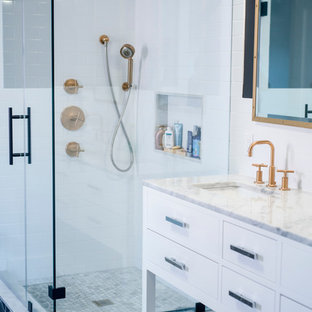 Inspiration for a large scandinavian master white tile and subway tile ceramic floor corner shower remodel in New York with flat-panel cabinets, white cabinets, white walls, an undermount sink and marble countertops