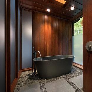Freestanding bathtub - mid-century modern master freestanding bathtub idea in New York