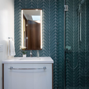 Example of a mid-sized 1950s kids' blue tile ceramic floor and white floor walk-in shower design in San Diego with flat-panel cabinets, white cabinets, white walls, an undermount sink, engineered quartz countertops, a hinged shower door and white countertops