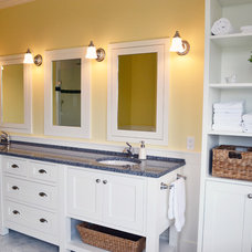 Farmhouse Bathroom by Mid Island Cabinets