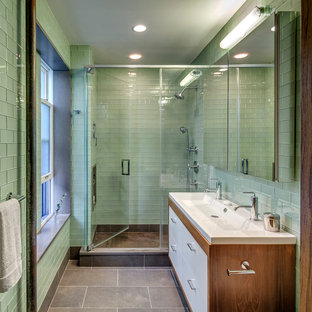 Example of a mid-sized mid-century modern 3/4 green tile and glass tile alcove shower design in Other with a trough sink, flat-panel cabinets, white cabinets and green walls