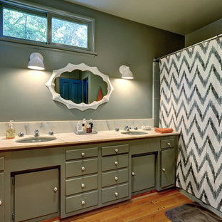 Bathroom - transitional bathroom idea in Los Angeles with marble countertops and green cabinets