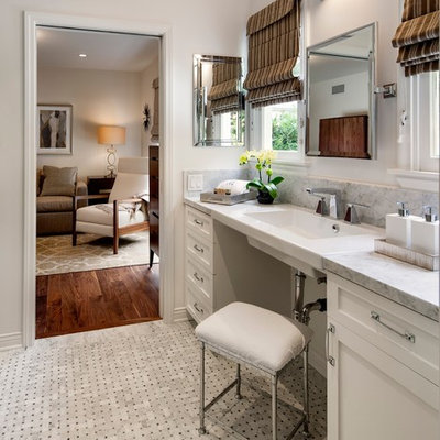 Mid-sized transitional gray tile and stone tile mosaic tile floor bathroom photo in Los Angeles with shaker cabinets, white cabinets, gray walls, a wall-mount sink, a one-piece toilet, marble countertops and gray countertops