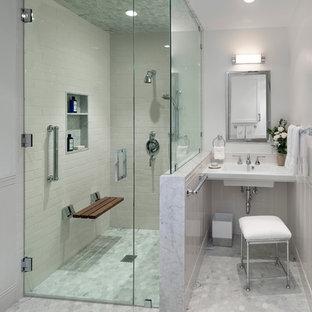 На фото: главная ванная комната среднего размера в стиле неоклассика (современная классика) с подвесной раковиной, белой плиткой, плиткой кабанчик, серыми стенами, полом из мозаичной плитки, отдельно стоящей ванной, угловым душем, серым полом, душем с распашными дверями, нишей и сиденьем для душа