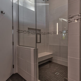 Example of a mid-sized 1950s master gray tile and porcelain tile porcelain tile and gray floor doorless shower design in Other with flat-panel cabinets, brown cabinets, a one-piece toilet, gray walls, an undermount sink, quartz countertops, a hinged shower door and white countertops