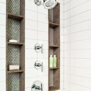 На фото: главная ванная комната в стиле модернизм с настольной раковиной, плоскими фасадами, темными деревянными фасадами, отдельно стоящей ванной, инсталляцией, белой плиткой, керамической плиткой и белыми стенами