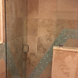 Inspiration for a mid-sized mediterranean 3/4 green tile and glass tile travertine floor and beige floor alcove shower remodel in Other with raised-panel cabinets, brown cabinets, a two-piece toilet, orange walls, an undermount sink, engineered quartz countertops and a hinged shower door