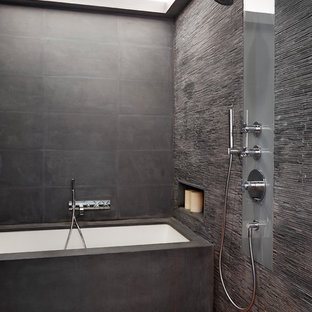 Example of a huge trendy master gray tile and matchstick tile medium tone wood floor bathroom design in New York with gray walls