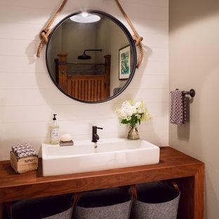 Esempio di una stanza da bagno country con nessun'anta, ante in legno bruno, pareti beige e lavabo rettangolare