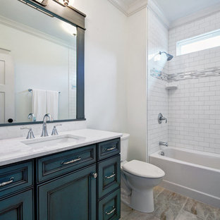 Mid-sized arts and crafts 3/4 gray tile, white tile and subway tile ceramic floor bathroom photo in Other with furniture-like cabinets, blue cabinets, a two-piece toilet, white walls, an undermount sink and engineered quartz countertops