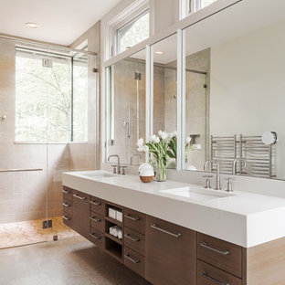 Large country master bathroom in Charlotte with flat-panel cabinets, medium wood cabinets, a curbless shower, beige tile, limestone, limestone floors, an undermount sink, engineered quartz benchtops, beige floor and a hinged shower door.