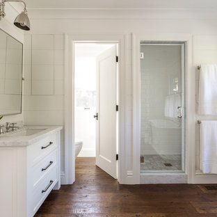 Design ideas for a large country master bathroom in San Francisco with an undermount sink, white cabinets, an alcove shower, white tile, white walls, dark hardwood floors, shaker cabinets, a freestanding tub, subway tile and brown floor.