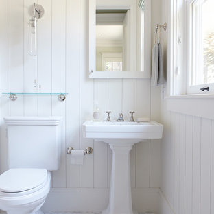 Traditional bathroom in San Francisco with a pedestal sink, a two-piece toilet and white tile.