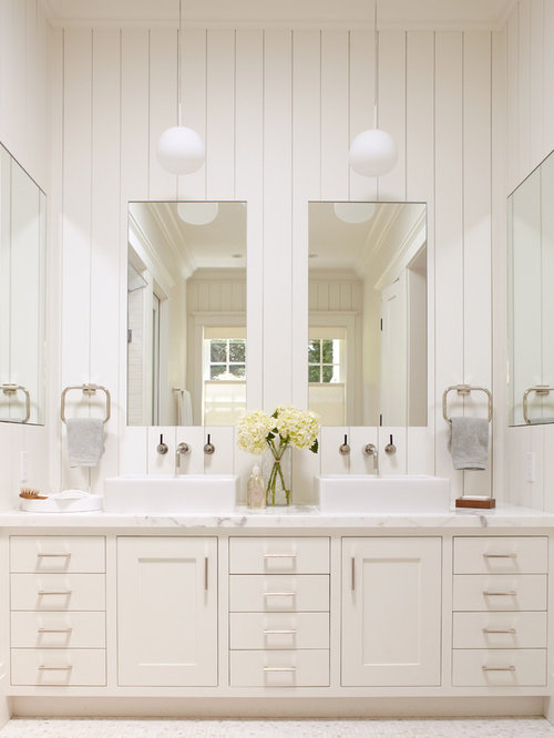 elegant bathroom photo in other with a vessel sink