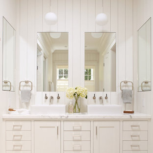 Elegant bathroom photo in San Francisco with a vessel sink and white countertops