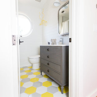 Inspiration for a transitional kids' mosaic tile floor and multicolored floor bathroom remodel in Sacramento with furniture-like cabinets, gray cabinets and white walls