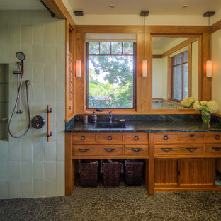 Bathroom - large craftsman green tile and glass tile bathroom idea in San Francisco with an integrated sink, medium tone wood cabinets, marble countertops and beige walls