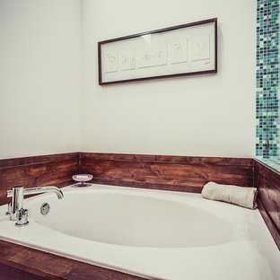 Photo of a midcentury master bathroom in Salt Lake City with flat-panel cabinets, dark wood cabinets, an open shower, blue tile, mosaic tile, a hinged shower door, a shower seat, a double vanity, a floating vanity and wood.