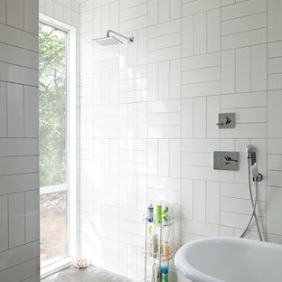 Trendy subway tile freestanding bathtub photo in Austin