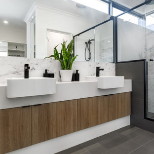 Photo of a large contemporary master bathroom in Perth with flat-panel cabinets, beige cabinets, an alcove shower, gray tile, porcelain tile, porcelain floors, a vessel sink, grey floor, a hinged shower door, white benchtops, a double vanity and a built-in vanity.