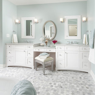 Example of a classic mosaic tile and white tile gray floor bathroom design in Minneapolis with recessed-panel cabinets and white cabinets