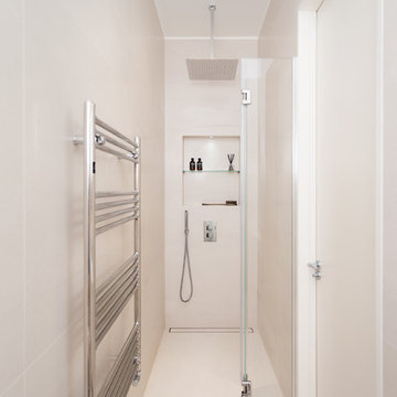 Minimalist shower solution for a tiny bathroom at our Netherhall Gardens Project
