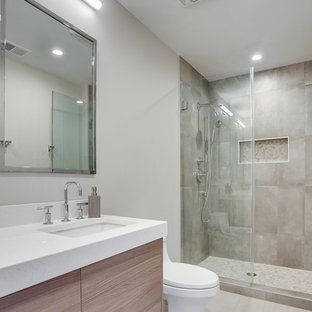 Inspiration for a small modern master bathroom in DC Metro with flat-panel cabinets, brown cabinets, a one-piece toilet, gray tile, porcelain tile, grey walls, porcelain floors, an undermount sink, engineered quartz benchtops, grey floor, a hinged shower door and yellow benchtops.